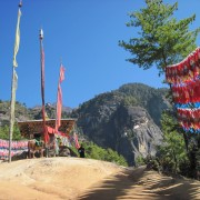 Taktsang Monastery viewpoint perched on a cliff at 3,000 feetoverlooking the valley florr. A mystical pilgrimage for visitors and locals alike. Legend has it that Guru Rinpoch flew to the site of the monastery on the back of a tigress from Tibet and meditated there for three months thus bringing Buddhism to Bhutan.